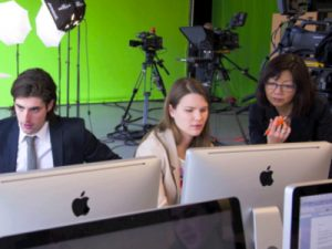 Susan Harada (right), current head of Carleton's journalism program, works with a team of TV students.