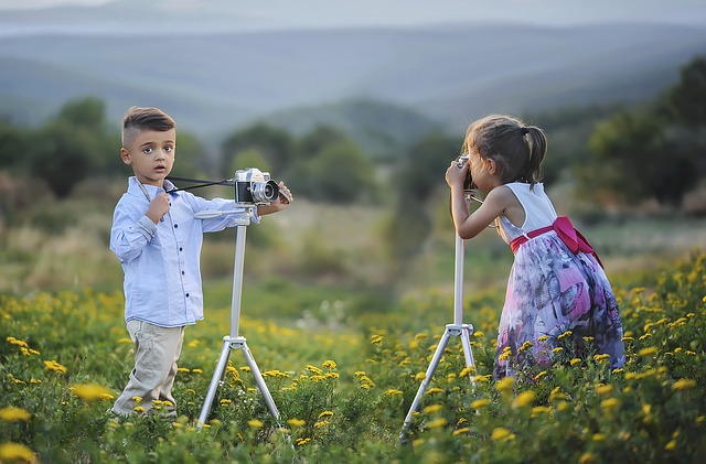 Boy and girl take photos of each other