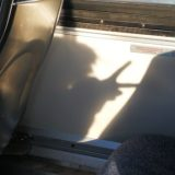 Charlotte makes a peace sign as a shadow puppet