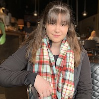 Sarah Donnelly in a restaurant wearing a tartan scarf.