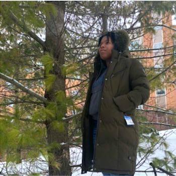 Makua in her winter coat under a tree