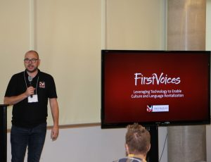 First Voices presenter beside his PowerPoint