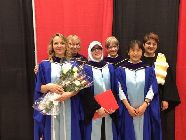 Chloe, Natasha, Nwara, Janna, Lin, and Eva in their graduation robes