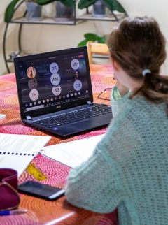 Young woman looks at computer screen