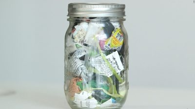 Glass jar filled with plastic waste