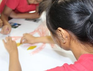 A girl coloring a picture