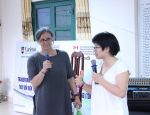 A woman and girl stand holding microphones