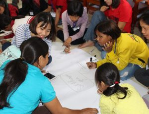 girls working together on a project