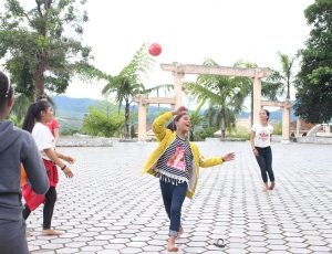 A group of girls is playing with a ball.