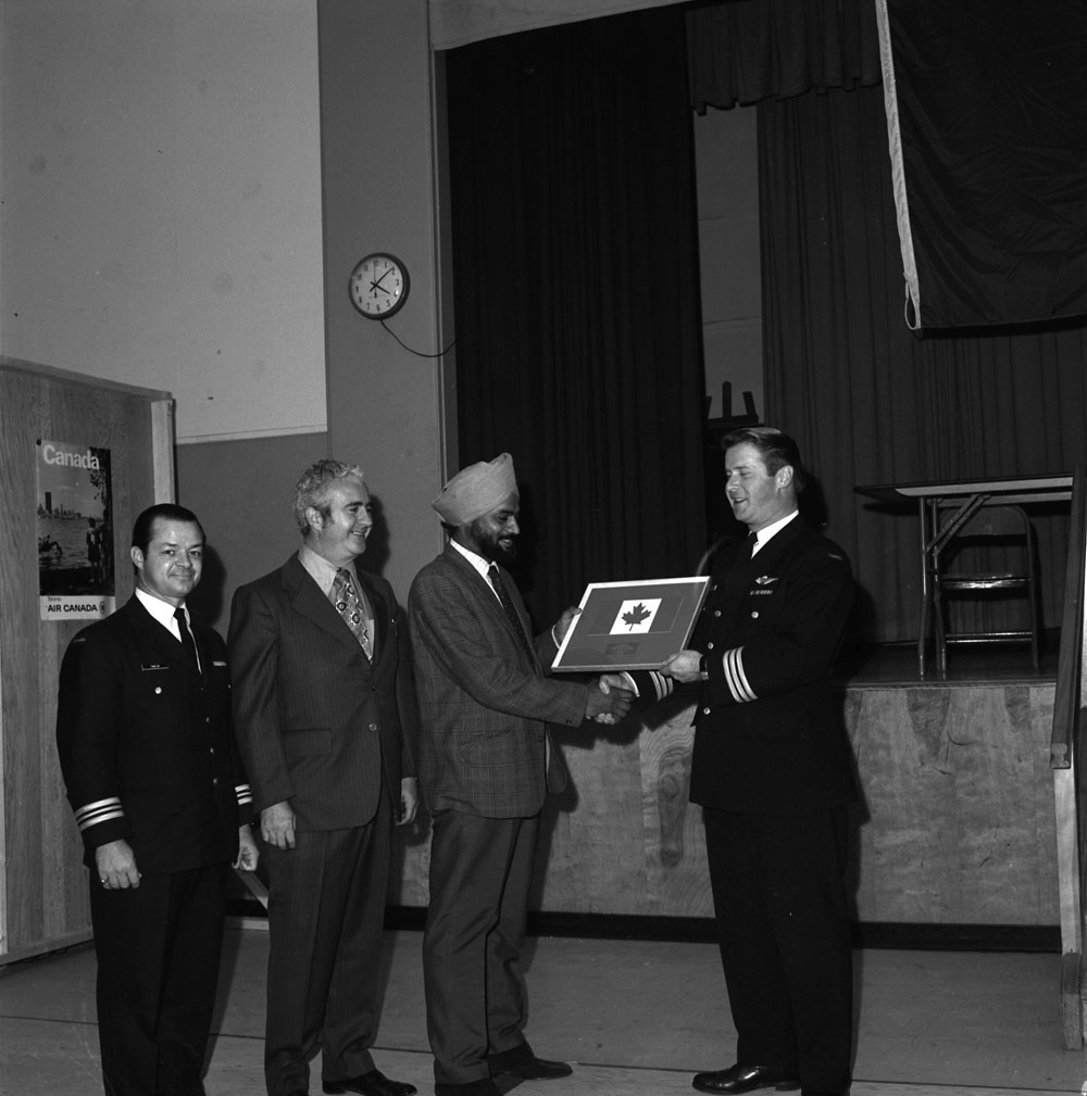 A Sikh man receiving citation as the 2000th refugee, Longue Pointe, 27 October 1972.