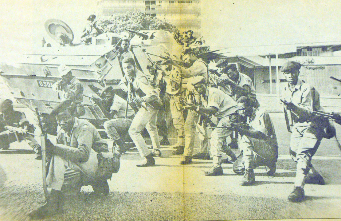 Photo of Ugandan military officers with their guns drawn. Uganda Argus Newspaper, January 1971